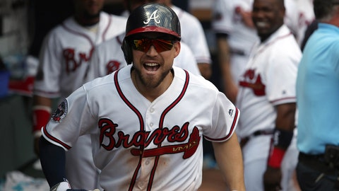Apr 16, 2017; Atlanta, GA, USA; Atlanta Braves center fielder Ender Inciarte (11) celebrates in the dugout after he hit a solo home run in the seventh inning of their game against the San Diego Padres at SunTrust Park. The Braves won 9-2. Mandatory Credit: Jason Getz-USA TODAY Sports