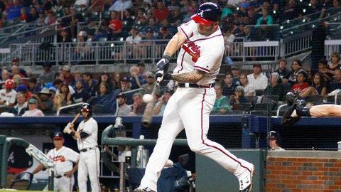 Jun 22, 2017; Atlanta, GA, USA; Atlanta Braves first baseman Matt Adams (18) hits a home run against the San Francisco Giants in the fourth inning at SunTrust Park. Mandatory Credit: Brett Davis-USA TODAY Sports