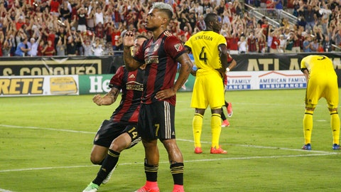 Jun 17, 2017; Atlanta, GA, USA; Atlanta United forward Josef Martinez (7) celebrates with midfielder Carlos Carmona (14) after scoring a goal against the Columbus Crew in the second half at Bobby Dodd Stadium at Historic Grant Field. Mandatory Credit: Brett Davis-USA TODAY Sports