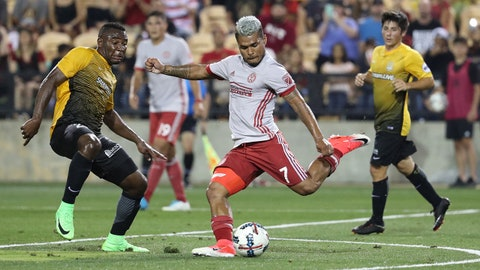 Jun 14, 2017; Atlanta, GA, USA; Atlanta United forward Josef Martinez (7) attempts a shot against Charleston Battery midfielder Tah Brian Anung (22) in the first half of their game at Fifth Third Bank Stadium. Mandatory Credit: Jason Getz-USA TODAY Sports