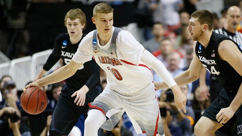 Mar 23, 2017; San Jose, CA, USA; Arizona Wildcats forward Lauri Markkanen (10) is defended by Xavier Musketeers forward Sean O'Mara (54) in the first half during the semifinals of the West Regional of the 2017 NCAA Tournament at SAP Center. Mandatory Credit: Stan Szeto-USA TODAY Sports