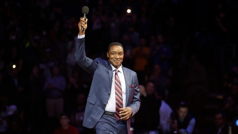 Former Detroit Pistons guard Isiah Thomas waves to the crowd during halftime of an NBA basketball game between the Detroit Pistons and the Los Angeles Lakers, Wednesday, Feb. 8, 2017, in Auburn Hills, Mich. Thomas was honored at halftime as part of the team's ongoing celebration of its years at The Palace. (AP Photo/Carlos Osorio)