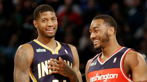 The winners of the slam dunk contest Paul George of the Indiana Pacers, John Wall of the Washington Capitals and Terrence Ross celebrate during the skills competition at the NBA All Star basketball game, Saturday, Feb. 15, 2014, in New Orleans. (AP Photo/Gerald Herbert)