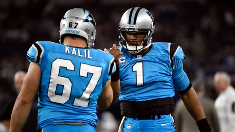 Carolina Panthers' Ryan Kalil and Cam Newton (1) greet each other at the start of an NFL football game against the Dallas Cowboys, Thursday, Nov. 26, 2015, in Arlington, Texas. (AP Photo/Michael Ainsworth)