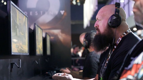 """IMAGE DISTRIBUTED FOR ACTIVISION - Paul Wight, """"Big Show,"""" visits the """"Destiny 2"""" booth during E3 2017 at the Los Angeles Convention Center on Tuesday, June 13, 2017, in Los Angeles. (Photo by Colin Young-Wolff/Invision for Activision/AP Images)"""