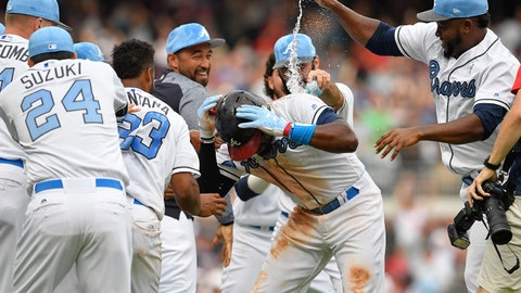 Jun 17, 2017; Atlanta, GA, USA; Atlanta Braves second baseman Brandon Phillips (4) celebrates with teammates after driving in the game winning run against the Miami Marlins during the tenth inning at SunTrust Park. Mandatory Credit: Dale Zanine-USA TODAY Sports