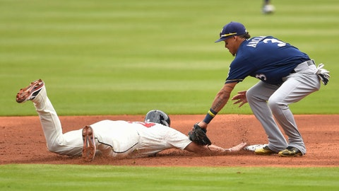 Jun 25, 2017; Atlanta, GA, USA; Atlanta Braves first baseman Matt Adams (18) gets tagged out by Milwaukee Brewers shortstop Orlando Arcia (3) after being picked off during the second inning at SunTrust Park. Mandatory Credit: Dale Zanine-USA TODAY Sports