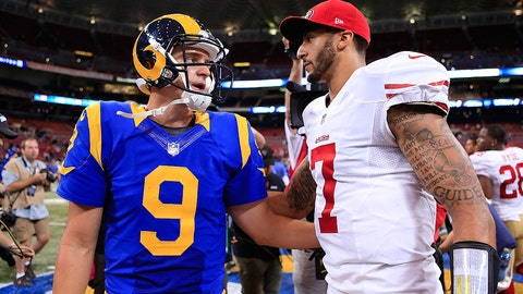 St. Louis Rams quarterback Austin Davis (9) talks with San Francisco 49ers quarterback Colin Kaepernick (7) after the 49ers beat the Rams in an NFL football game Monday, Oct. 13, 2014, in St Louis. The 49ers won 31-17. (AP Photo/Billy Hurst)