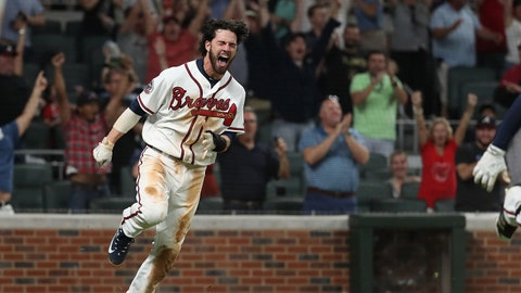 Jun 9, 2017; Atlanta, GA, USA; Atlanta Braves shortstop Dansby Swanson (7) reacts after scoring the winning run off of a single by third baseman Rio Ruiz (not pictured) in the ninth inning against the New York Mets at SunTrust Park. Mandatory Credit: Jason Getz-USA TODAY Sports