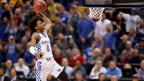 Kentucky's De'Aaron Fox heads to the basket during the second half of a second-round game against Wichita State in the men's NCAA college basketball tournament Sunday, March 19, 2017, in Indianapolis. Kentucky won 65-62. (AP Photo/Jeff Roberson)