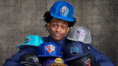 NEW YORK, NEW YORK - MAY 16: Draft prospects De'Aaron Fox poses with draft caps for portraits prior to the 2017 NBA Draft Lottery at the NBA Headquarters in New York, New York. NOTE TO USER: User expressly acknowledges and agrees that, by downloading and or using this Photograph, user is consenting to the terms and conditions of the Getty Images License Agreement.  Mandatory Copyright Notice: Copyright 2017 NBAE (Photo by Jennifer Pottheiser/NBAE via Getty Images)