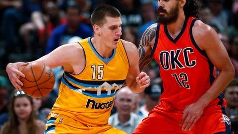 Denver Nuggets forward Nikola Jokic (15) tries to go around Oklahoma City Thunder center Steven Adams (12) during the first half of an NBA basketball game, Sunday, April 9, 2017, in Denver. (AP Photo/Jack Dempsey)