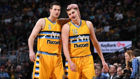 DENVER, CO - MARCH 10: Danilo Gallinari #8 and Nikola Jokic #15 of the Denver Nuggets are seen during the game against the Boston Celtics on March 10, 2017 at the Pepsi Center in Denver, Colorado. NOTE TO USER: User expressly acknowledges and agrees that, by downloading and/or using this Photograph, user is consenting to the terms and conditions of the Getty Images License Agreement. Mandatory Copyright Notice: Copyright 2017 NBAE (Photo by Garrett Ellwood/NBAE via Getty Images)