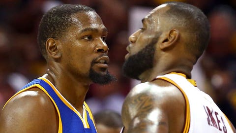CLEVELAND, OH - JUNE 07:  Kevin Durant #35 of the Golden State Warriors and LeBron James #23 of the Cleveland Cavaliers look on in the second quarter in Game 3 of the 2017 NBA Finals at Quicken Loans Arena on June 7, 2017 in Cleveland, Ohio. NOTE TO USER: User expressly acknowledges and agrees that, by downloading and or using this photograph, User is consenting to the terms and conditions of the Getty Images License Agreement.  (Photo by Ronald Martinez/Getty Images)