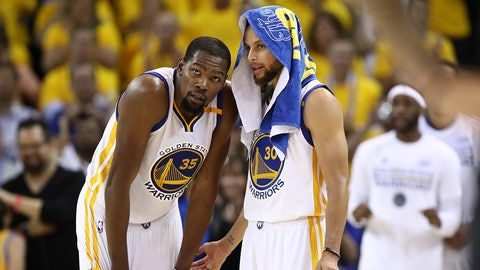 OAKLAND, CA - JUNE 12: Kevin Durant #35 and Stephen Curry #30 of the Golden State Warriors discuss the play against the Cleveland Cavaliers during the second half in Game 5 of the 2017 NBA Finals at ORACLE Arena on June 12, 2017 in Oakland, California. NOTE TO USER: User expressly acknowledges and agrees that, by downloading and or using this photograph, User is consenting to the terms and conditions of the Getty Images License Agreement.  (Photo by Ezra Shaw/Getty Images)