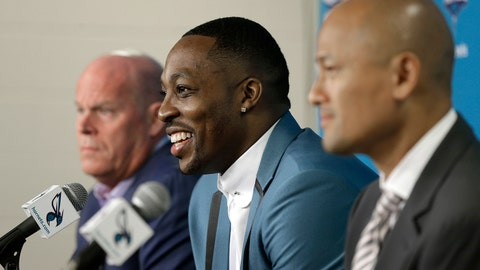 Charlotte Hornets NBA basketball player Dwight Howard, center, speaks to the media as general manager Rich Cho, right, and head coach Steve Clifford, left, look on during a news conference in Charlotte, N.C., Monday, June 26, 2017 after being traded to the Hornets by the Atlanta Hawks last week. (AP Photo/Chuck Burton)