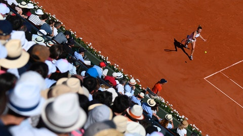 The crowd watches Romania's Simona Halep return the ball to Latvia's Jelena Ostapenko during their final tennis match at the Roland Garros 2017 French Open on June 10, 2017 in Paris.  / AFP PHOTO / GABRIEL BOUYS        (Photo credit should read GABRIEL BOUYS/AFP/Getty Images)