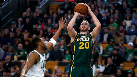 Utah Jazz's Gordon Hayward (20) shoots over Boston Celtics' Evan Turner (11) during the first quarter of an NBA basketball game in Boston, Monday, Feb. 29, 2016. (AP Photo/Michael Dwyer)
