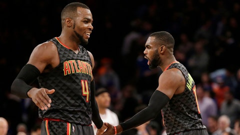 Atlanta Hawks' Paul Millsap, left, and Tim Hardaway Jr. celebrate after an NBA basketball game against the New York Knicks, Monday, Jan. 16, 2017 in New York. The Hawks defeated the Knicks 108-107. (AP Photo/Seth Wenig)