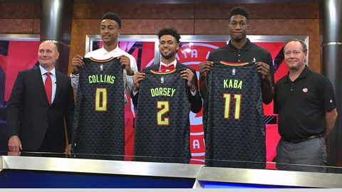 Atlanta Hawks general manager Travis Schlenk, left, stands with coach Mike Budenholzer, right, and with draft picks John Collins, Tyler Dorsey and Alpha Kaba, Monday, June 26, 2017, in Atlanta. (AP Photo/Charles Odum)