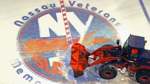 UNIONDALE, NY - MAY 05:  A payloader removes the ice from the Nassau Coliseum on May 5, 2015 in Uniondale, New York. The New York Islanders have played their last game at the Nassau Coliseum and will begin to play at the Barclay's Center in the Brooklyn borough of New York City next season.  (Photo by Bruce Bennett/Getty Images)