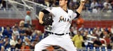 Marlins roughed up in series opener vs. Cubs