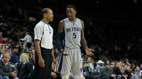 Detroit Pistons guard Kentavious Caldwell-Pope (5) talks with NBA official Eric Lewis after the Pistons were whistled for a foul during the second half of an NBA basketball game against the Toronto Raptors Friday, March 17, 2017, in Auburn Hills, Mich. The Raptors defeated the Pistons 87-75. (AP Photo/Duane Burleson)
