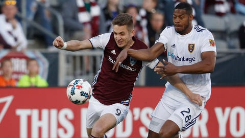 Colorado Rapids forward Kevin Doyle, left, works the ball as Real Salt Lake defender Chris Schuler slows him during the first half of an MLS soccer match Saturday, April 15, 2017, in Commerce City, Colo. (AP Photo/David Zalubowski)