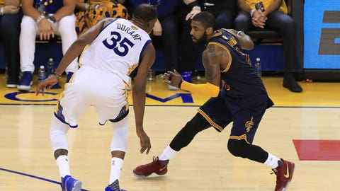 OAKLAND, CA - JUNE 01: Kyrie Irving #2 of the Cleveland Cavaliers is defended by Kevin Durant #35 of the Golden State Warriors during the second half of Game 1 of the 2017 NBA Finals at ORACLE Arena on June 1, 2017 in Oakland, California. NOTE TO USER: User expressly acknowledges and agrees that, by downloading and or using this photograph, User is consenting to the terms and conditions of the Getty Images License Agreement.  (Photo by Ronald Martinez/Getty Images)