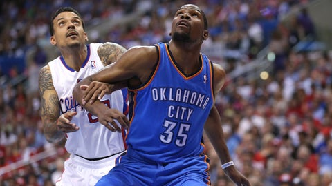 LOS ANGELES, CA - MAY 11: Kevin Durant #35 of the Oklahoma City Thunder and Matt Barnes #22 of the Los Angeles Clippers fight for position under the boards in Game Four of the Western Conference Semifinals during the 2014 NBA Playoffs at Staples Center on May 11, 2014 in Los Angeles, California.   The Clippers won 101-99.  NOTE TO USER: User expressly acknowledges and agrees that, by downloading and or using this photograph, User is consenting to the terms and conditions of the Getty Images License Agreement.  (Photo by Stephen Dunn/Getty Images)