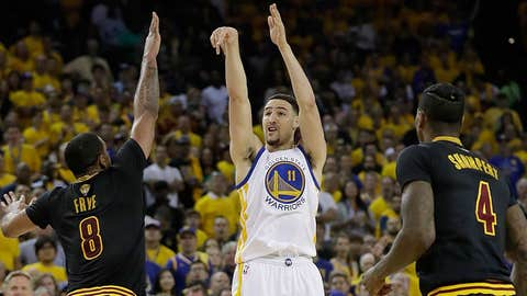 Golden State Warriors guard Klay Thompson (11) shoots against the Cleveland Cavaliers during the first half of Game 2 of basketball's NBA Finals in Oakland, Calif., Sunday, June 4, 2017. (AP Photo/Marcio Jose Sanchez)