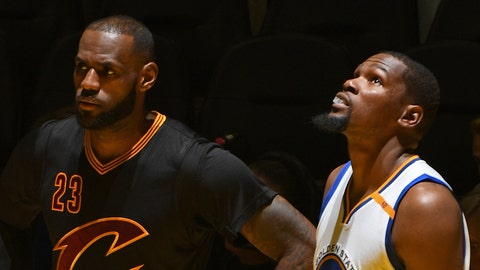 OAKLAND, CA - JUNE 4:  LeBron James #23 of the Cleveland Cavaliers and Kevin Durant #35 of the Golden State Warriors stand on the court in Game Two of the 2017 NBA Finals on June 4, 2017 at Oracle Arena in Oakland, California. NOTE TO USER: User expressly acknowledges and agrees that, by downloading and or using this photograph, user is consenting to the terms and conditions of Getty Images License Agreement. Mandatory Copyright Notice: Copyright 2017 NBAE (Photo by Garrett Ellwood/NBAE via Getty Images)