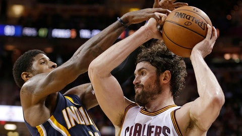 Indiana Pacers' Paul George (13) blocks a pass by Cleveland Cavaliers' Kevin Love (0) in the second half of an NBA basketball game Monday, Feb. 29, 2016, in Cleveland. The Cavaliers won 100-96. (AP Photo/Tony Dejak)