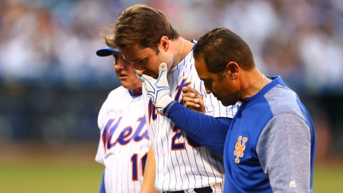 NEW YORK, NEW YORK - JUNE 14:  Neil Walker #20 of the New York Mets is helped off the field after being injured on a play in the third inning against the Chicago Cubs at Citi Field on June 14, 2017 in the Flushing neighborhood of the Queens borough of New York City.  (Photo by Mike Stobe/Getty Images)