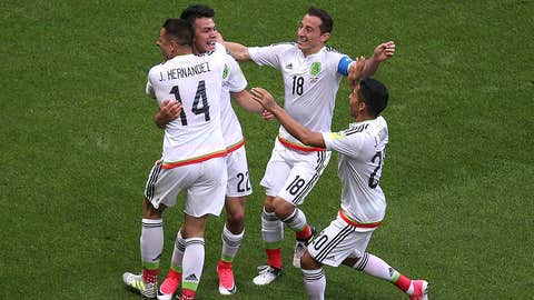 Mexico's forward Hirving Lozano (2nd L) celebrates a second goal during the 2017 Confederations Cup group A football match between Mexico and Russia at the Kazan Arena Stadium in Kazan on June 24, 2017. / AFP PHOTO / Roman Kruchinin        (Photo credit should read ROMAN KRUCHININ/AFP/Getty Images)