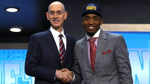NEW YORK, NY - JUNE 22:  Donovan Mitchell walks on stage with NBA commissioner Adam Silver after being drafted 13th overall by the Denver Nuggets during the first round of the 2017 NBA Draft at Barclays Center on June 22, 2017 in New York City. NOTE TO USER: User expressly acknowledges and agrees that, by downloading and or using this photograph, User is consenting to the terms and conditions of the Getty Images License Agreement.  (Photo by Mike Stobe/Getty Images)