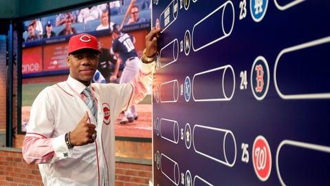 Hunter Greene, a pitcher and shortstop from Notre Dame High School in Sherman Oaks, Calif., poses for photographs after putting his name on the board moments after being selected No. 2 by the Cincinnati Reds in the first round of the Major League Baseball draft, Monday, June 12, 2017, in Secaucus, N.J.(AP Photo/Julio Cortez)