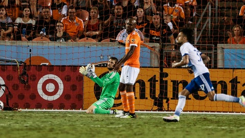 Houston Dynamo goalkeeper Tyler Deric, rear, reacts after he was scored on by FC Dallas forward Maximiliano Urruti (37) during the second half of an MLS soccer match Friday, June 23, 2017, in Houston. (Brett Coomer/Houston Chronicle via AP)