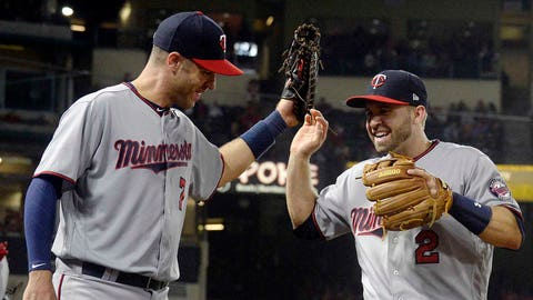 Thursday, June 1: Minnesota Twins second baseman Brian Dozier is greeted by first baseman Joe Mauer after the two hooked up with Miguel Sano to turn a triple play in the fourth inning. The Twins won 4-2.