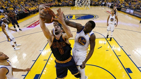 Golden State Warriors forward Draymond Green (23) defends a shot by Cleveland Cavaliers forward Kevin Love (0) during the first half of Game 1 of basketball's NBA Finals in Oakland, Calif., Thursday, June 1, 2017. (AP Photo/Marcio Jose Sanchez, Pool)