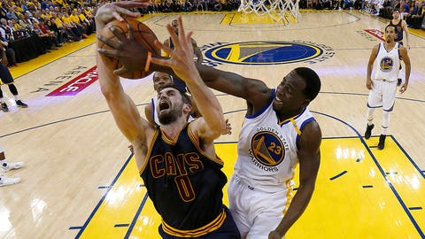 OAKLAND, CA - JUNE 01:  Draymond Green #23 of the Golden State Warriors defends Kevin Love #0 of the Cleveland Cavaliers in Game 1 of the 2017 NBA Finals at ORACLE Arena on June 1, 2017 in Oakland, California. NOTE TO USER: User expressly acknowledges and agrees that, by downloading and or using this photograph, User is consenting to the terms and conditions of the Getty Images License Agreement.  (Photo by Marcio Jose Sanchez/Pool/Getty Images)