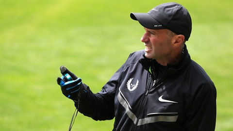 BEAVERTON, OR - APRIL 13:  Coach Alberto Salazar of the Nike Oregon Project times athletes as they train on the grass at the Nike campus on April 13, 2013 in Beaverton, Oregon.  (Photo by Doug Pensinger/Getty Images)