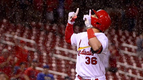 Jun 14, 2017; St. Louis, MO, USA; St. Louis Cardinals shortstop Aledmys Diaz (36) celebrates after hitting a two run home run off of Milwaukee Brewers relief pitcher Jacob Barnes (not pictured) as heavy rain falls during the eighth inning at Busch Stadium. Mandatory Credit: Jeff Curry-USA TODAY Sports