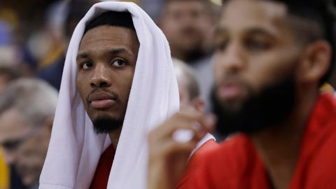 Portland Trail Blazers' Damian Lillard, left, and Allen Crabbe watch from the bench in the closing minutes of the team's 110-81 loss to the Golden State Warriors ipn Game 2 of a first-round NBA basketball playoff series Wednesday, April 19, 2017, in Oakland, Calif. (AP Photo/Marcio Jose Sanchez)