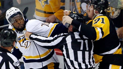 Nashville Predators' P.K. Subban, left, and Pittsburgh Penguins' Evgeni Malkin, right, square off as linesman Brad Kovachik tries to separate them during the third period in Game 2 of the NHL hockey Stanley Cup Final, Wednesday, May 31, 2017, in Pittsburgh. (AP Photo/Gene J. Puskar)