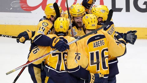 Nashville Predators left wing Filip Forsberg (9), of Sweden, is congratulated after scoring an empty net goal against the Pittsburgh Penguins during the third period in Game 4 of the NHL hockey Stanley Cup Finals Monday, June 5, 2017, in Nashville, Tenn. The Predators won 4-1 to tie the series 2-2. (AP Photo/Mark Humphrey)