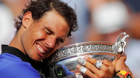 Spain's Rafael Nadal holds the trophy as he celebrates winning his tenth French Open title against Switzerland's Stan Wawrinka in three sets, 6-2, 6-3, 6-1, during their men's final match of the French Open tennis tournament at the Roland Garros stadium, in Paris, France, Sunday, June 11, 2017. (AP Photo/Christophe Ena)