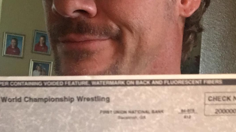Jericho shared a photo of a check he received from WCW in 2000 that was worth less than the stamp used to mail it