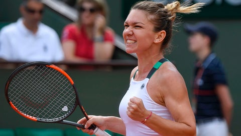 Romania's Simona Halep celebrates after winning against Spain's Carla Suarez Navarro their tennis match at the Roland Garros 2017 French Open on June 5, 2017 in Paris.  / AFP PHOTO / FRANCOIS XAVIER MARIT        (Photo credit should read FRANCOIS XAVIER MARIT/AFP/Getty Images)