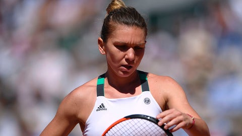 Romania's Simona Halep reacts after a point against Latvia's Jelena Ostapenko during their final tennis match at the Roland Garros 2017 French Open on June 10, 2017 in Paris.  / AFP PHOTO / Eric FEFERBERG        (Photo credit should read ERIC FEFERBERG/AFP/Getty Images)